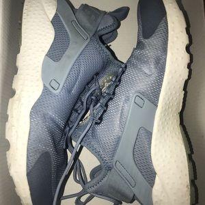 Light blue Nike huaraches